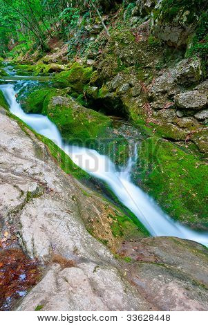 Stream Flowing Between The Rocks