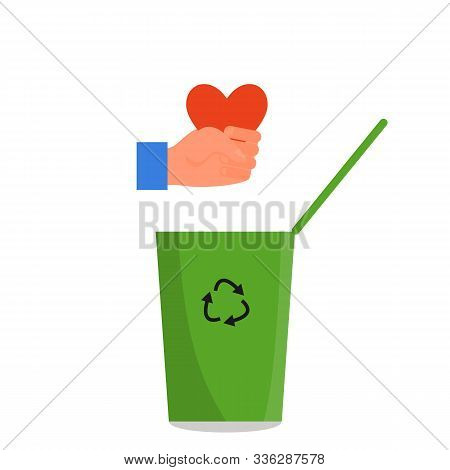 Caucasian Human Hand Holding Red Heart In Fist Over The Green Trash Can. Concept Of Divorce, Tough B
