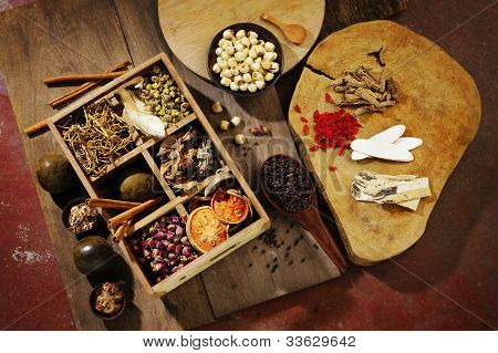 Chinese herbal medicine and flower tea on wooden poster