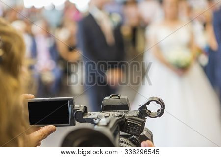 Screen And Part Of A Video Camera Of An Operator Taking An Event Or A Wedding. Left Blank Black Vide