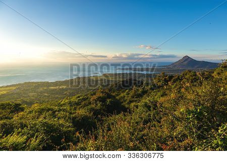 View Of The Mountain, Ocean And Tamarin In The Evening, Mauritius.