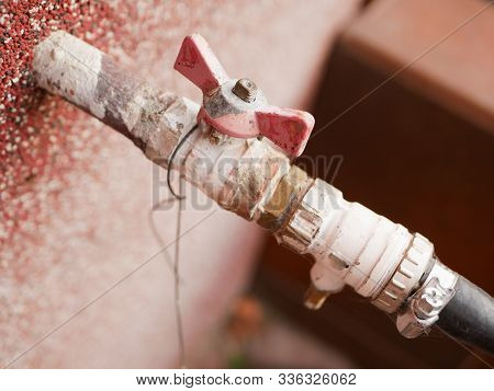 Outer Hose. Water Tap On The Street. Watering The Site. Outdoor Water