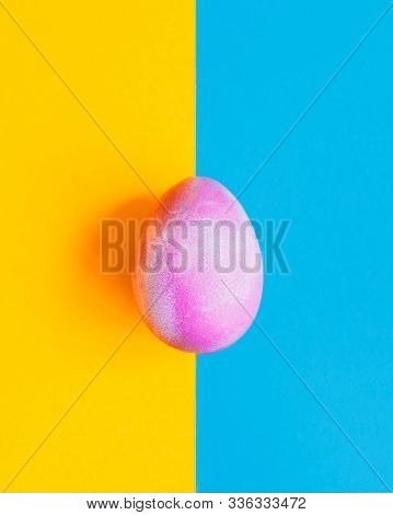 Cosmic Galactic Easter Egg On Blue And Yellow Pastel Background
