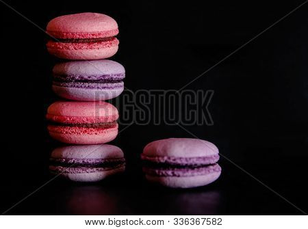 Macarons On Dark Background, Colorful French Cookies Macarons. Macarons