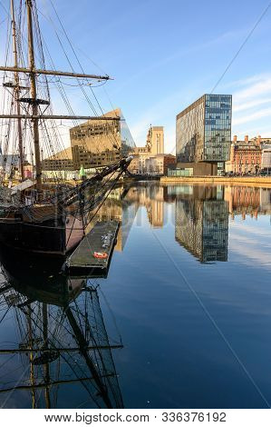 Vertical Shot Of Tall Ship And Modern Office Buildings Surrounding Canning Dock Redevelopment In Liv