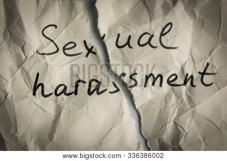 Sexual Harassment Concept. Torn Pieces Of Crumpled Paper With The Words Sexual Harassment.