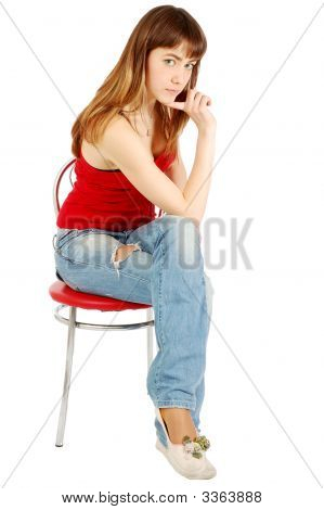 Pretty Girl Posing Sitting On A Chair