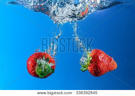 Strawberries On Black Background Under Water Bubbles Reflections Green Fruit Delicious  Taste Sweet