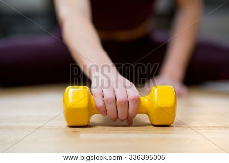 Girls Hand Reaches For A Lying Dumbbell, Selective Focus