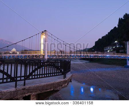Berat, Albania - September 28, 2019: Illuminated Modern Suspension Bridge Over The River Osum Connec