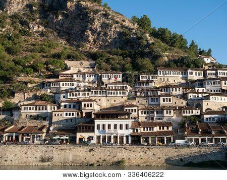 Berat, Albania - September 27, 2019: Ottoman Houses With Multiple Windows Built On A Hillside In Ber