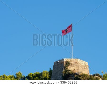 Unfurled Albanian Flag With Black Double-headed Eagle On A Red Background, Flying At Berati Castle O