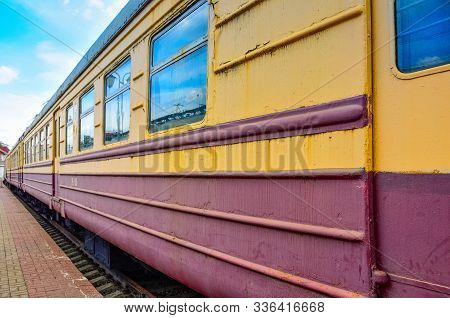 Yellow-red Train Carriage, Old Carriage On The Platform, Side View Of The Train Carriage, Windows On