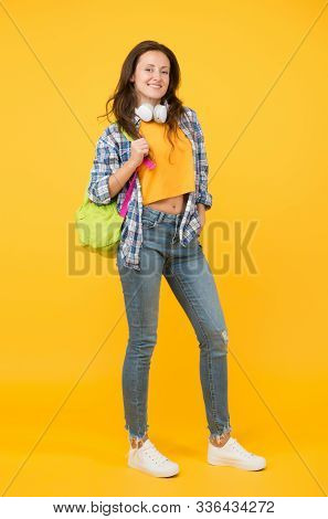 Brainy Is New Sexy. Happy Student Yellow Background. University Student Carry Backpack. Pretty Stude