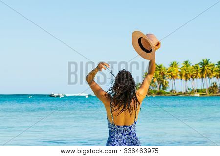 Traveler Girl Relaxing On Tropical Beach In Vacation. Young Girl Traveler Relaxing In Vacation. Trav