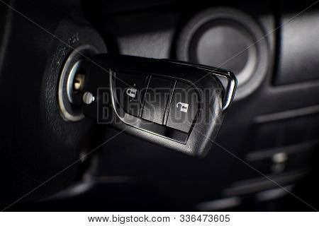 Car Keyless Remote On A Keyhole In A Car.
