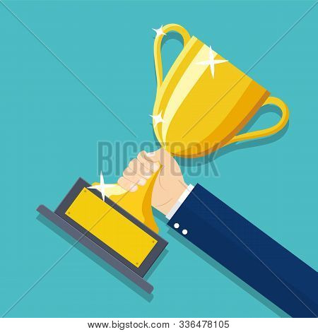 Businessman Hand Holding Gold Trophy Cup. Winner Trophy Award. First Place. Gold Trophy Cup. Winner