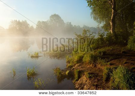 Sunrise with fog over the lake