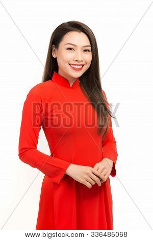 Happy Lunar New Year. Asian Girl In Vietnamese Traditional Dress (ao Dai) On White Background