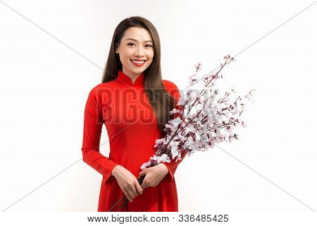 Asian Woman With Vietnamese Traditional Dress Ao Dai Holding Peach Blossom Flower For Decorations