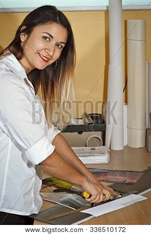 Manually Crop Photos. Knife And Ruler On The Table. Framing Pictures With A Stationery Knife. Girl I