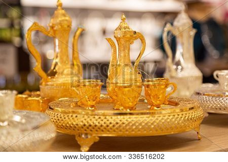 Gilded Tea Set In The Store. A Set Of Utensils For Tea And Coffee With Gilding Is On Display At The