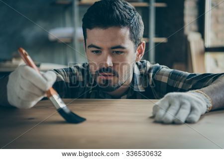 Closeup Photo Of Skilled Professional Handsome Guy Covering Slab Table Waterproof Varnish Paint Brus