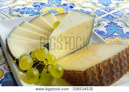 Spanish Sheep Cheese Served With White Grapes Close Up