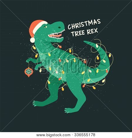 Tyrannosaurus Christmas Tree Rex Card. Dinosaur In Santa Hat Decorates Christmas Tree Garland Lights