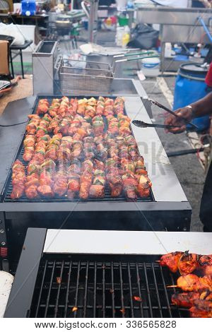 Grilling Chicken, Beef And Pork Kabobs At A Night Market