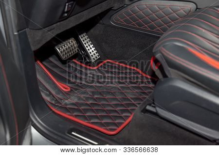 Dirty Car Floor Mats Of Black Rubber With Gas Pedals And Brakes In The Workshop For The Detailing Ve