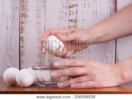 Female Hands Broking Fresh Raw White Eggs As Ingredient