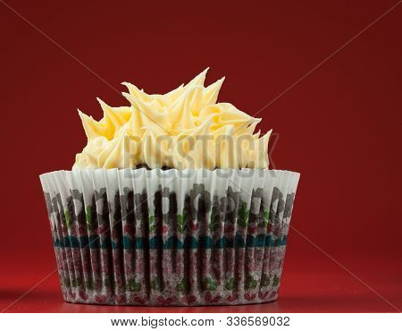 Chocolate Cupcake With Vanilla Spikes Icing, Red Background