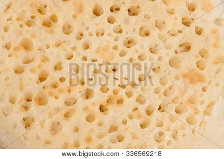 Closeup On The Texture Of A British Breakfast Crumpet
