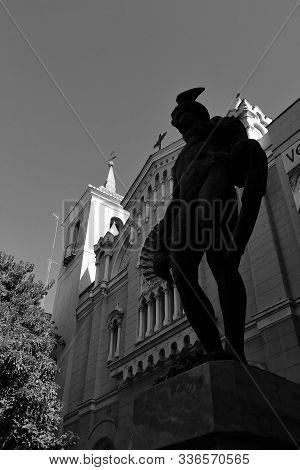 Murcia, Spain- November 16, 2019: Beautiful San Bartolome Parish Facade In Murcia. Mercury God Statu