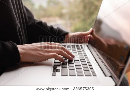 Email Marketing And Newsletter Concept. Hand Of Man Sending Message And Laptop.
