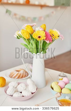 Spring And Easter Holiday Concept With Copy Space. Template Easter Greeting Card. Easter Eggs And Fl
