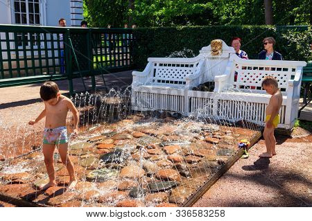 St. Petersburg, Russia - June 25, 2019: Children Frolic In The Fountain Jets. Fountain-cracker