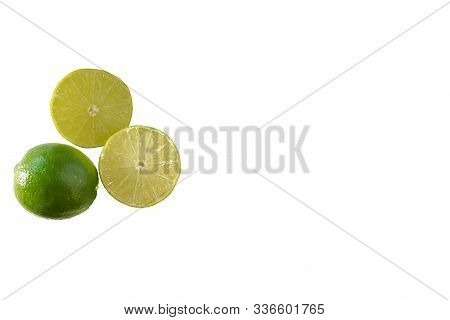Two Lime Halves Isolated On A White Background With Copy Space To The Right