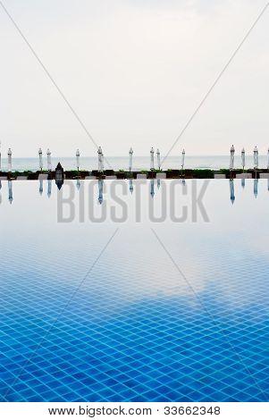 White Umbrella And Swimming Pool