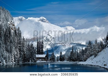 Tea House  At Lake Agnes In Mountains Covered With Snow By Blue Alpine Lake. Lake Louise Area In Ban