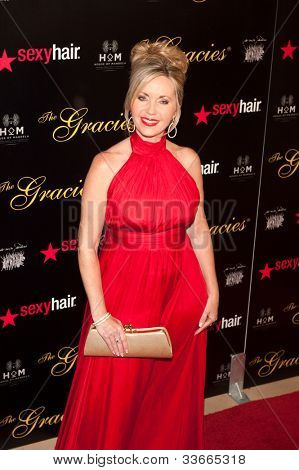 BEVERLY HILLS, CA - MAY 21: Deb Carson arrives at the 2012 Gracie Awards Gala on May 21st 2012 at the Beverly Hills Hilton in Beverly Hills.