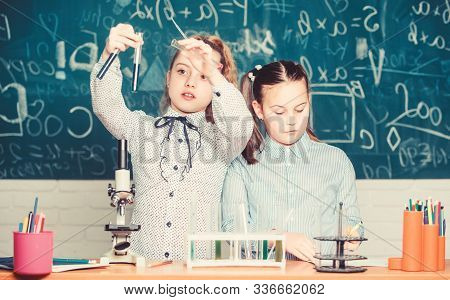 Little Kids Learning Chemistry. Chemistry Equipment. Students Do Biology Experiments With Microscope