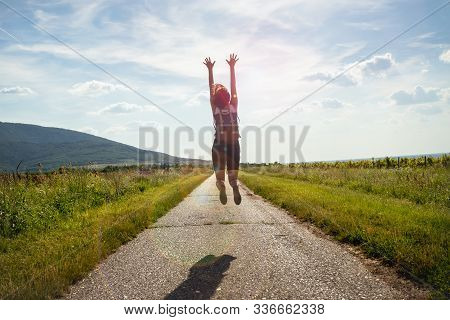 Woman Jumping In Nature In Sunset. People In Nature.. Beautiful Woman In Meadow Summer. Beautiful Pe