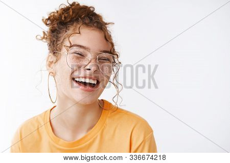 Carefree Joyful Happy Young Lucky Redhead Girl Wearing Glasses Messy Curly Bun Haircut Laughing Ador