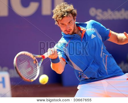 BARCELONA - APRIL, 24: Latvian tennis player Ernests Gulbis in action during his match against Bernard Tomic of Barcelona tennis tournament Conde de Godo on April 24, 2012 in Barcelona