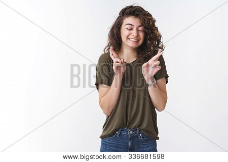 Dreamy Cute Lucky Young Girl Praying Believe Miracle Close Eyes Smiling Broadly Cross Fingers While