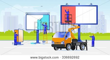 Workers Mount Posters Using Stairs And Aerial Work Platforms. Street Advertising On A Billboard Conc