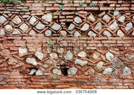 The Ruin Of An Ancient Brick-stone Patterned Delphi Wall In Greece