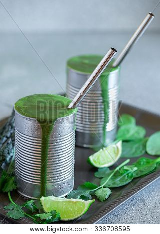 Healthy Kale And Spinach Smoothies Served In Repurposed Metal Cans With Stainless Steel Drinking Str